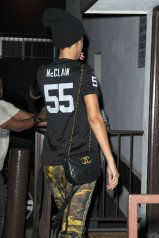 Rihanna-wearing-Oakland-Raiders-Football-Jersey-Adidas-Jeremy-Scott-Zipped-Camo-Track-Pants-and-Supra-Sneakers