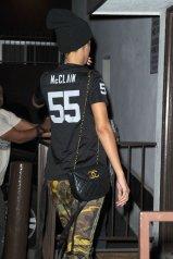 Rihanna-wearing-Oakland-Raiders-Football-Jersey-Adidas-Jeremy-Scott-Zipped-Camo-Track-Pants-and-Supra-Sneakers